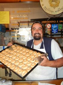Scanno baker showing off his famous almond flour cookies.