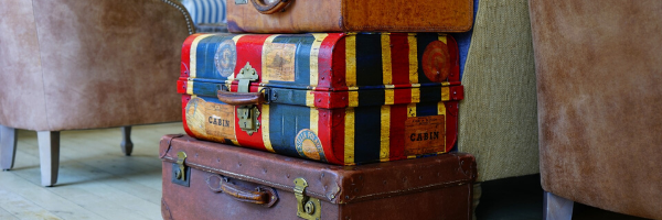 Three suitcases stacked and ready to travel to Abruzzo Italy.